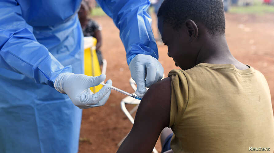 FILE - A Congolese health worker administers Ebola vaccine to a boy who had contact with an Ebola sufferer in the village of Mangina in North Kivu province of the Democratic Republic of the Congo, Aug. 18, 2018.