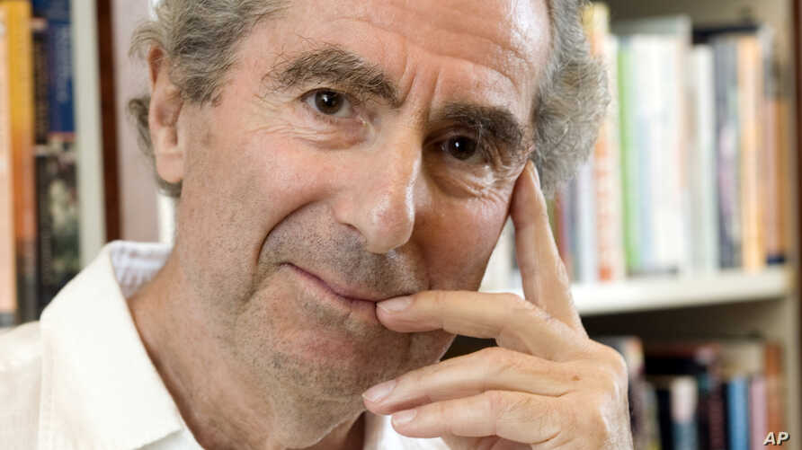 FILE - In this Sept. 8, 2008 file photo, author Philip Roth poses for a photo in the offices of his publisher Houghton Mifflin, in New York.