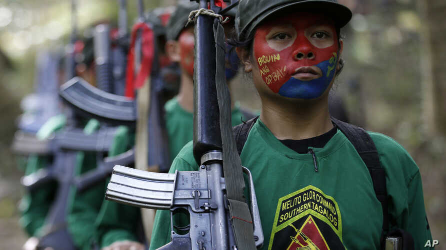 FILE - Мembers of the New People's Army communist rebels,
