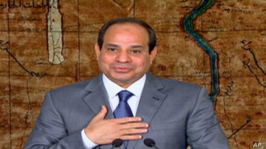 Egyptian President Abdel-Fattah el-Sissi speaks in a nationally televised broadcast in Cairo, July 7, 2014.