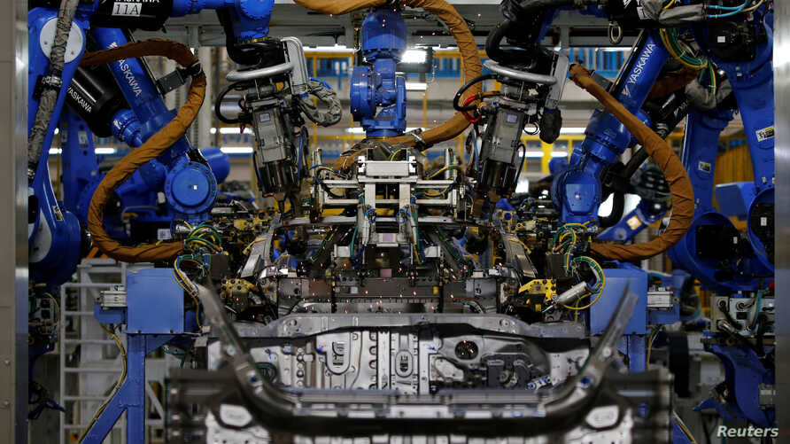 A robot is seen in the automobile production line of the new Honda plant in Prachinburi, Thailand, May 12, 2016.