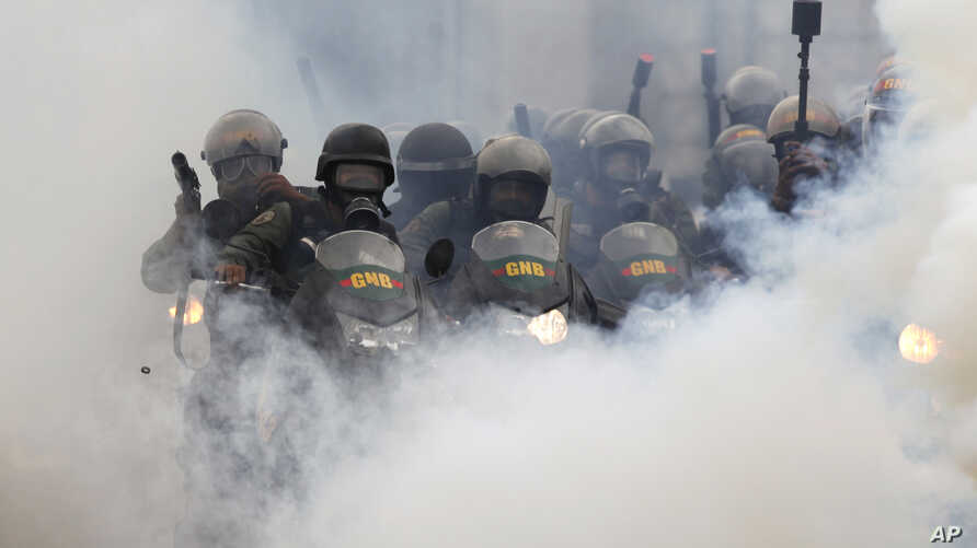 Bolivarian National Guards block students attempting to march to the Education Ministry amid tear gas in Caracas, Venezuela, May 8, 2017.