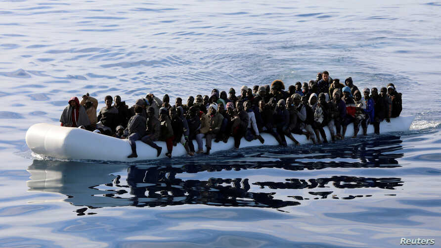 Migrants are seen in a rubber dinghy as they are rescued by the Libyan coast guard in the Mediterranean Sea off the coast of Libya, Jan. 15, 2018.