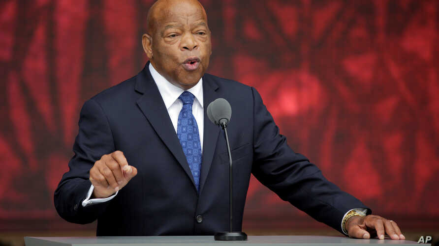 U.S. Rep. John Lewis, D-Georgia, speaks at the dedication of the Smithsonian's National Museum of African American History and Culture in Washington, D.C., Sept. 24, 2016. Lewis won a National Book Award for a graphic novel about his civil rights ac