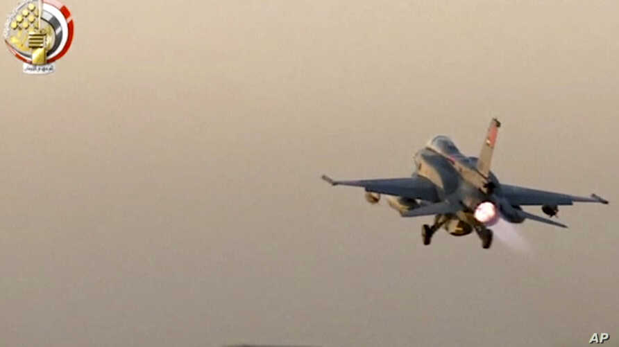 In this still image taken from video provided by the Egyptian military, an Egyptian fighter jet takes off from an undisclosed location in Egypt to strike militant hideouts in the Libyan city of Darna, May 26, 2017.