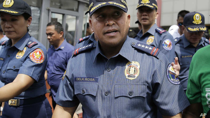 Philippine National Police Chief Ronald dela Rosa walks after an anti-terror simulation exercise at a bus terminal in Quezon city, north of Manila, Philippines, April 11, 2017.