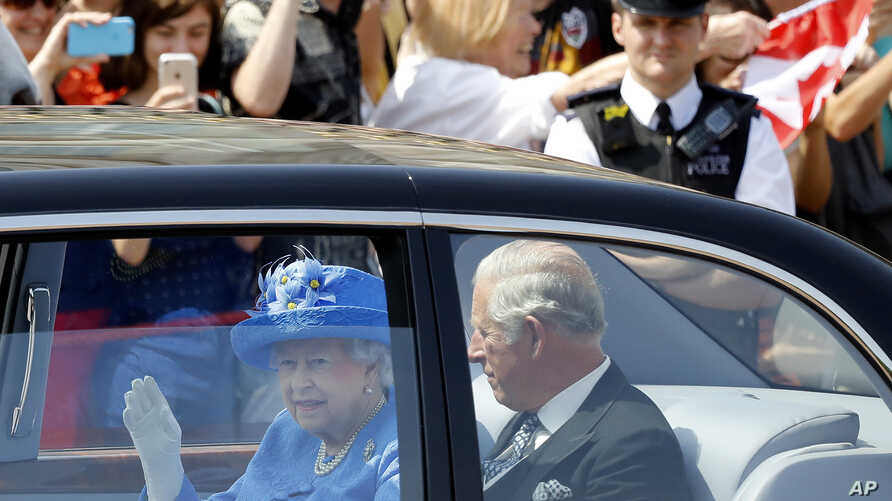 Britain's Queen Elizabeth II leaves Buckingham Palace with Prince Charles to travel to parliament for the state opening of Parliament in London, June 21, 2017.