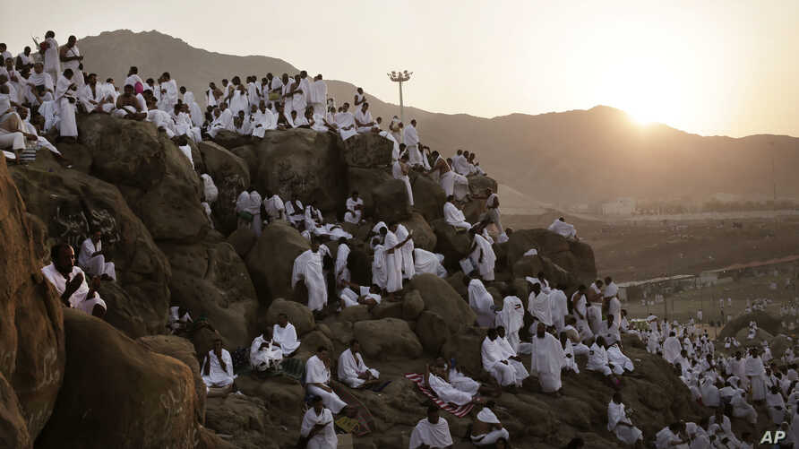 Muslim pilgrims pray on a rocky hill known as Mountain of Mercy, on the Plain of Arafat, during the annual hajj pilgrimage, ahead of sunrise near the holy city of Mecca, Saudi Arabia, Sept. 11, 2016.