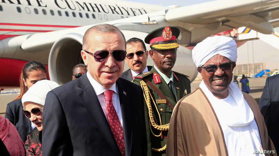 Sudan's President Omar al-Bashir welcomes Turkey's President Tayyip Erdogan at Khartoum Airport, Sudan, Dec. 24, 2017.