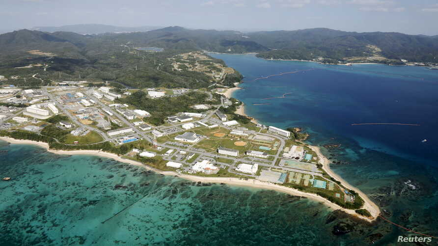 FILE - Coral reefs are seen along the coast near the U.S. Marine base Camp Schwab, off the tiny hamlet of Henoko in Nago, on the southern Japanese island of Okinawa, in this file aerial photo taken by Kyodo.