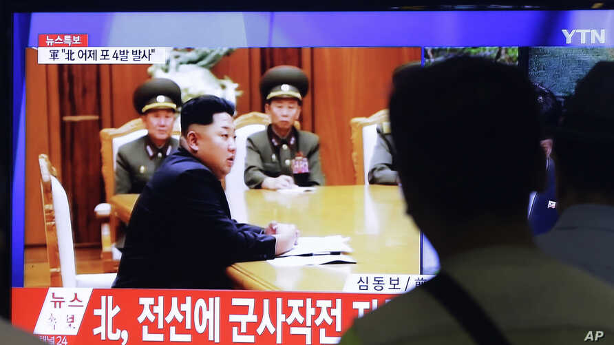 South Koreans watch television images showing North Korean leader Kim Jong Un, at a train station in Seoul, South Korea, Aug. 21, 2015.