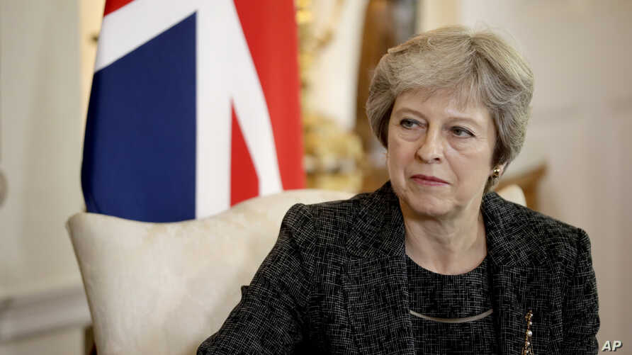 """British Prime Minister Theresa May, seen in this  July 24, 2018 file photo, has told the BBC in an interview scheduled for broadcast Monday, Sept. 17, 2018, that she gets """"irritated"""" by the debate over her leadership during Brexit negotiations."""