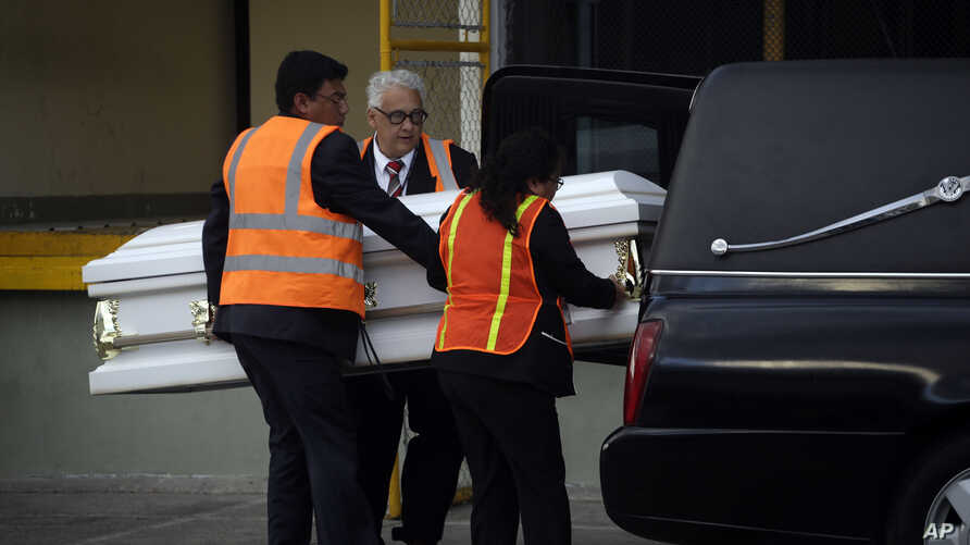 Mortuary employees carry the body of Jakelin Caal Maquin after her remains were repatriated to Guatemala, at La Aurora International Airport in Guatemala City, Dec. 23, 2018. Caal Maquin, 7, died in a Texas hospital two days after being taken into cu