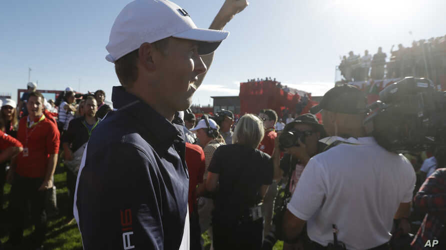 United States' Jordan Spieth reacts after the USA team won the Ryder Cup golf tournament, Oct. 2, 2016.