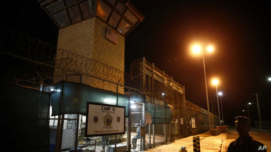 FILE - The entrance to Camp VI detention facility is guarded at Guantanamo Bay Naval Base, Cuba, Nov. 20, 2013.