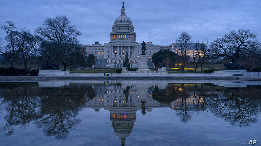 The Capitol is seen under early morning skies in Washington, Dec. 20, 2018.