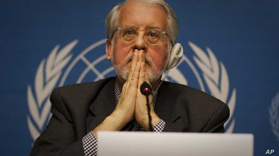 Brazilian Paulo Sergio Pinheiro, who is mandated by the UN Human Rights Council to lead an international investigation of allegations of human rights abuses in Syria, gestures during a press conference at the UN headquarters in Geneva, November 28, 2