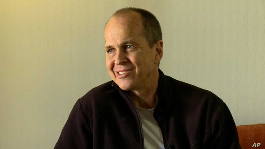 """In this image made from video, Australian journalist Peter Greste speaks during an interview a day after his release from prison in Egypt, in Larnaca, Cyprus, Monday, Feb. 2, 2015. Greste said Monday that his freedom was something of a """"rebirth"""" and ..."""