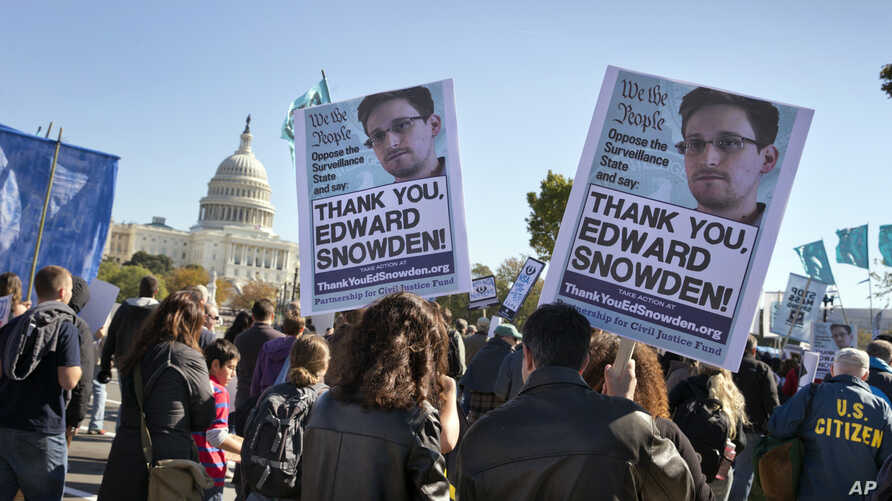 Demonstrators rally at the U.S. Capitol to protest spying on Americans by the National Security Agency in Washington on Oct. 26, 2013. (AP)