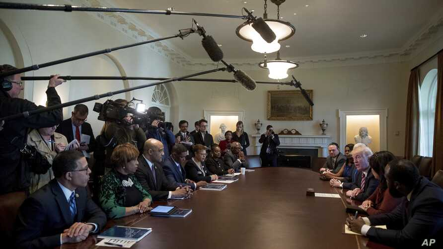 President Donald Trump meets with members of the Congressional Black Caucus in the Cabinet Room of the White House in Washington, March 22, 2017.