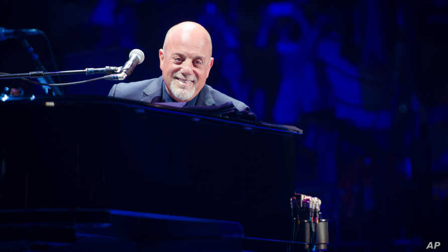 FILE - Billy Joel performs at Madison Square Garden in New York, May 9, 2014.