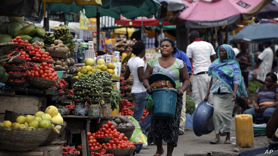 Women sell vegetables and other food in a market on World Food Day in Lagos, Nigeria, Tuesday, Oct. 16, 2012. One in eight people around the world goes to bed hungry every night, according to the United Nations.