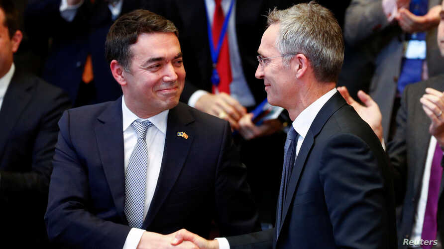 Macedonian Foreign Minister Nikola Dimitrov shakes hands with NATO Secretary-General Stoltenberg during a signature ceremony of the accession protocol between the Republic of North Macedonia and NATO at the Alliance headquarters in Brussels, Feb. 6,
