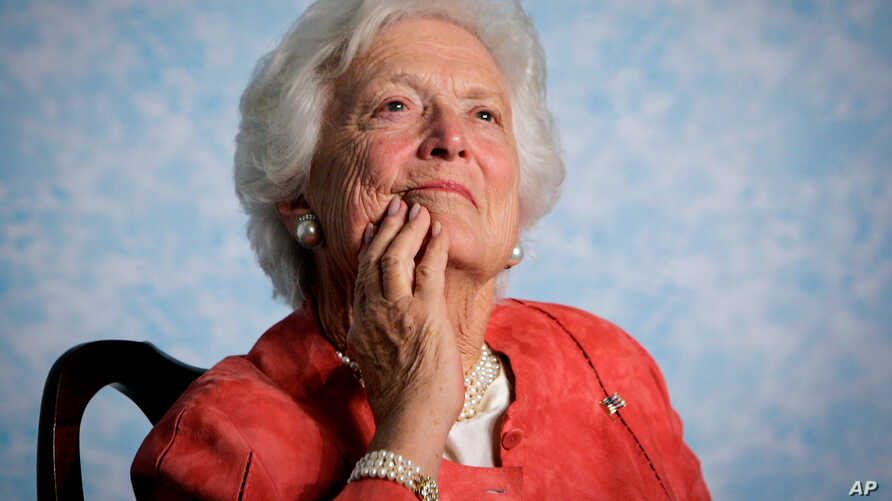 FILE - Former first lady Barbara Bush listens to her son, President George W. Bush, as he speaks on Social Security reform in Orlando, Florida, March 18, 2005.