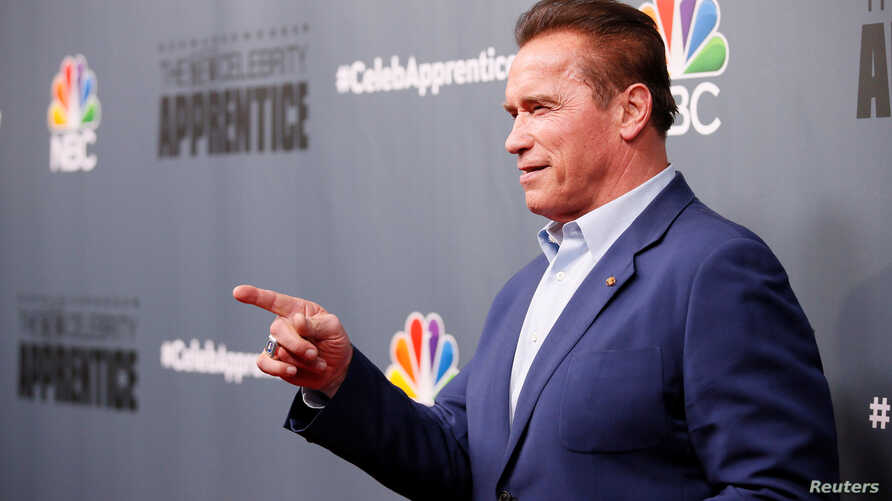 """Host Arnold Schwarzenegger poses after a panel for """"The New Celebrity Apprentice"""" in Universal City, California, Dec. 9, 2016."""