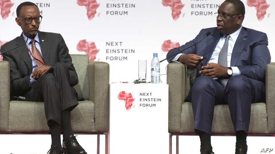 """Senegalese President Macky Sall and Rwandan President Paul Kagame are seen speaking at the opening of the """"Next Einstein Forum"""" in Dakar, March 8, 2016."""