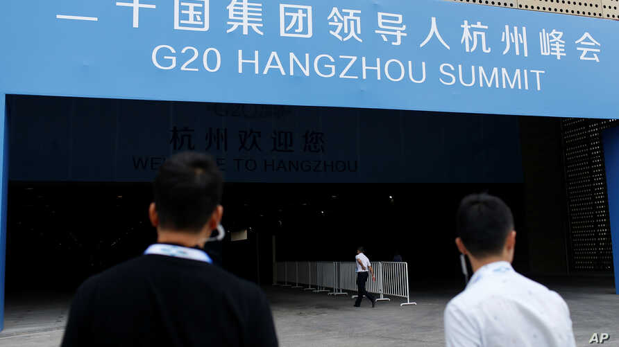 Security personnel patrol in front of the entrance of a conference centre, where the G20 summit will be held, in Hangzhou, Zhejiang Province, China, Sept. 1, 2016.
