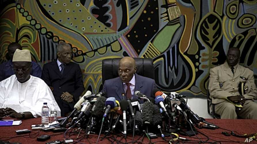 Senegal's President Abdoulaye Wade speaks to journalists at a news conference in Dakar, February 27, 2012. Wade was locked in a tight race with his main rival, Macky Sall, on Monday as unofficial vote tallies pointed to a possible run-off between the