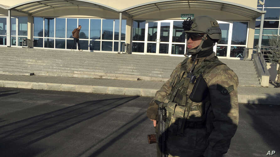 A paramilitary police officer stands at the entrance of Silivri Prison and Courthouse complex where 29 Turkish former police officers are on trial in the outskirts of Istanbul, Dec. 27, 2016.