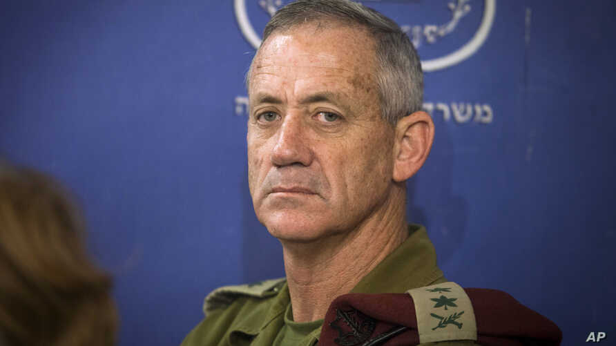 FILE - In this July 31, 2014 file photo, then-Chief of General Staff of the Israel Defense Forces Lt. Gen. Benny Gantz attends a Cabinet meeting at the Defense Ministry, in Tel Aviv, Israel.