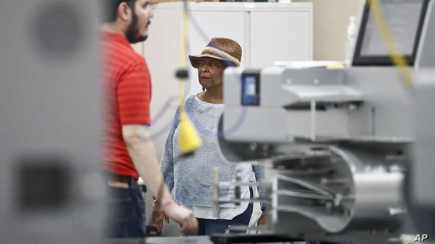 Broward County Supervisor of Elections, Brenda Snipes, walks through the vote count room during an election recount, Nov. 11, 2018, in Lauderhill, Florida