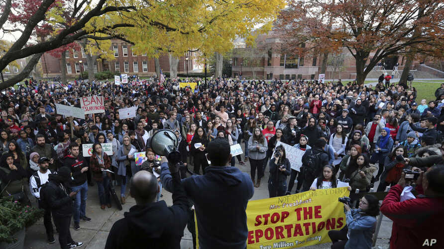 A large crowd gathers during a protest over some of President elect Donald Trump policies and to ask school officials to reject some of his plans at Rutgers University.
