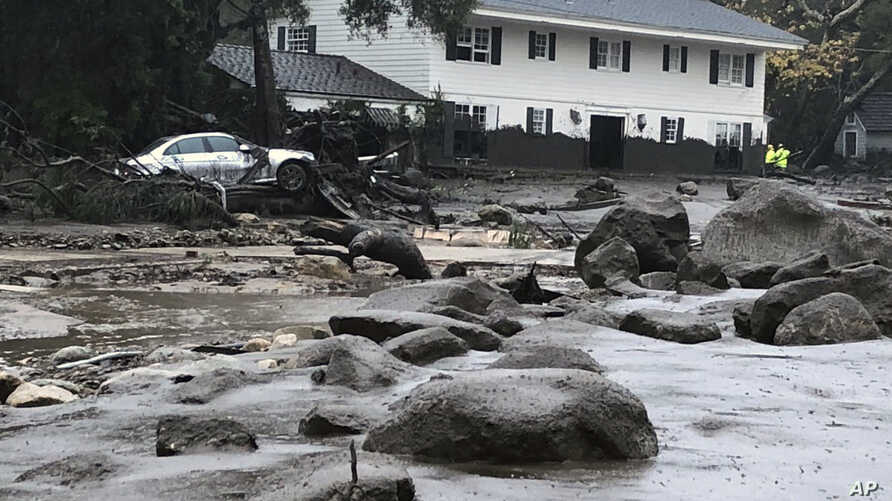 In this photo provided by Santa Barbara County Fire Department, mud and debris is shown due to heavy rain in Montecito. California, Jan. 9, 2018.