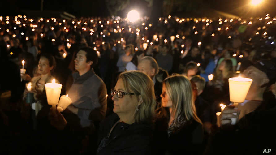 Community members gather for a candlelight vigil for those killed in a shooting at Umpqua Community College in Roseburg, Oregon, Oct. 1, 2015.