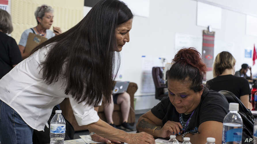 Deb Haaland, center, a member of the Laguna Pueblo, speaks with campaign organizers ahead of Democratic Primary elections at the Haaland headquarters in Albuquerque, New Mexico Tuesday afternoon June 5, 2018.