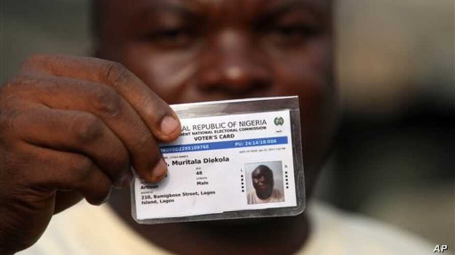 Muritala Diekola, display his new voters registration card in Lagos, Nigeria, Saturday, Jan. 15, 2011. An effort to register 70 million voters across Nigeria before its April presidential election wobbled to a start Saturday, as volunteers fought wit