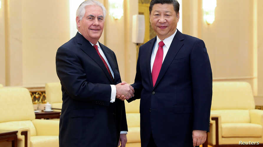 Chinese President Xi Jinping shakes hands with U.S. Secretary of State Rex Tillerson before their meeting at at the Great Hall of the People, March 19, 2017, in Beijing, China.