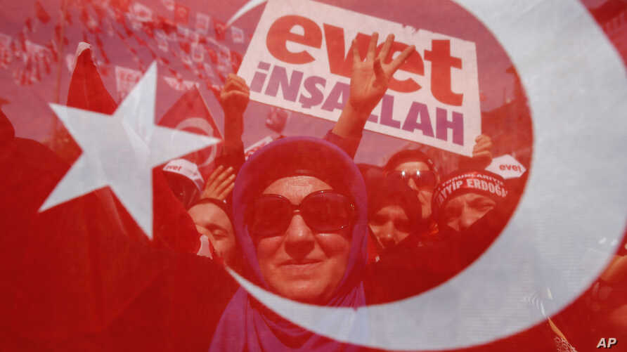 Supporters wait for the arrival of Turkey's President Recep Tayyip Erdogan for a last referendum rally in Istanbul, Saturday, April 15, 2017.