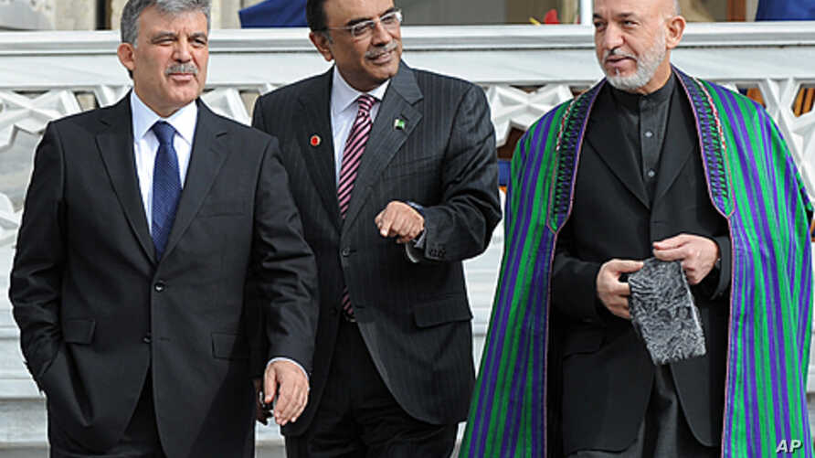 Turkish President Abdullah Gul, left, his Afghan counterpart Hamid Karzai, right, and President Asif Ali Zardari of Palistan walk after a meeting in Istanbul, Turkey. Turkey is hosting a conference this week on creating a regional strategy for improv