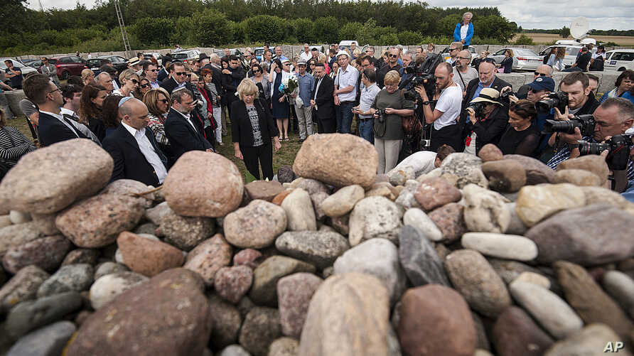 FILE - Jews from Poland and abroad gather for commemorations marking the 75th anniversary of a massacre of Jews in Jedwabne, Poland, July 10, 2016. Polish Jews are objecting to the possible exhumation of remains at the site, saying it would violate J
