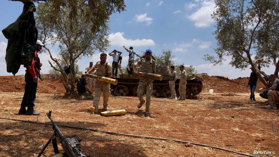Free Syrian Army fighters prepare their ammunition during what they said was an offensive against forces loyal to Syria's President Bashar al-Assad in the southern city of Dara'a, June 25, 2015.
