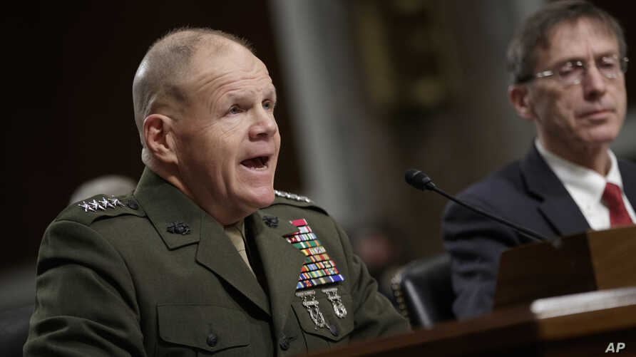 Marine Gen. Robert B. Neller, left, commandant of the Marine Corps, and Acting Navy Secretary Sean J. Stackley, appear before the Senate Armed Services Committee on the investigation of nude photographs of female Marines and other women that were sha