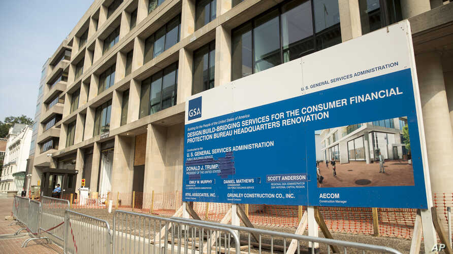 A sign stands at the construction site for the Consumer Financial Protection Bureau's new headquarters in Washington, Aug. 27, 2018. Seth Frotman, the nation's top government official overseeing the $1.5 trillion student loan market resigned Monday.