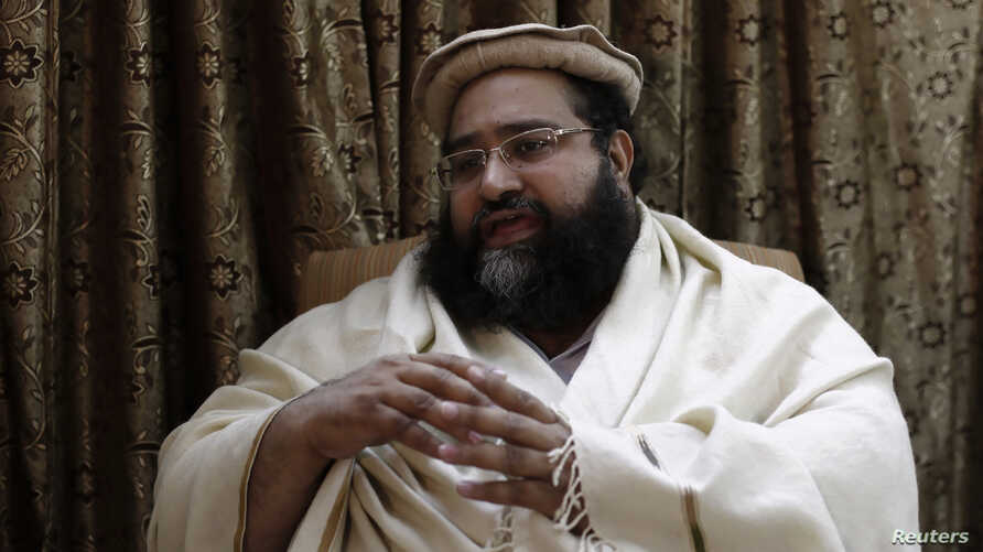 FILE - Muhammad Tahir Ashrafi, head of the powerful Ulema Council of clerics, speaks during an interview with Reuters in Islamabad.