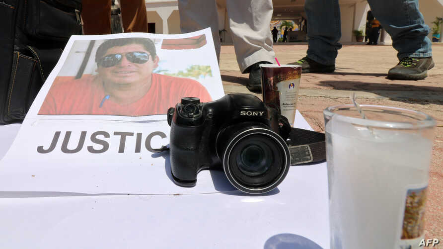 An image of Mexican journalist Jose Guadalupe Chan is seen as his colleagues protest outside the City Hall in Playa del Carmen, Quintana Roo state, Mexico, June 30, 2018. The reporter was fatally shot Friday, the state's prosecutor and the site Chan