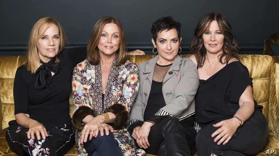 "FILE - The Go-Go's band members, from left, Charlotte Caffey, Belinda Carlisle, Jane Wiedlin and Kathy Valentine pose together during previews for the new Broadway musical ""Head Over Heels"" in New York, July 12, 2018."
